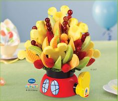 Mickey Mouse Clubhouse Party Bouquet   Edible Arrangements®  I wonder If i can put the hubby's old produce pro skills to the test :)
