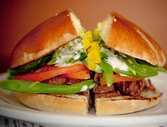 A terrific Chilean sandwich not unlike a Mexican torta: thinly sliced beef, mild melted cheese, avocado, tomato, mayo, chiles, and stringbeans, on a smooth and slightly sweet housemade bread that makes all the difference.