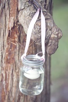 candles floating in mason jars  hung from trees for a wedding reception or evening party. :) | Wedding Chicks