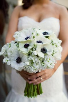 White anemone bouquet with white filler flowers, white anemone is where the eye is drawn to