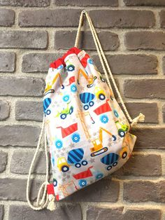 Check out this item in my Etsy shop https://www.etsy.com/uk/listing/613887019/handmade-kids-fabric-backpack-with