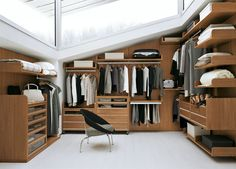 closets are usually so dark...i love the natural lighting in this one
