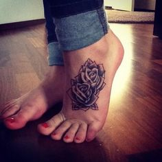 foot tattoo rose http://tattoomagz.com/great-foot-tattoos-design/great-flowers-foot-tattoo/
