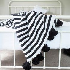 Moroccan Pom Pom Blanket | Black & White Stripe #worthynzhomeware wwworthy.co.nz