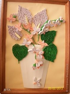 Quilled peace lillies and orchids in a vase.