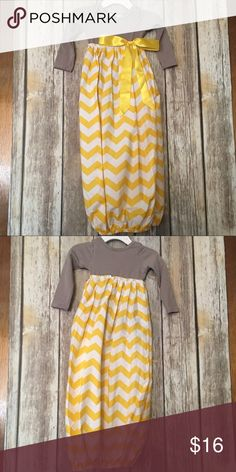 Gray And Yellow Gold Chevron Print Gown Adorable chevron print gown. Top part is a long sleeve gray onesie. Bottom part is chevron print with elastic around bottom. Has attached yellow ribbon that can be tied how you would like. Size is xs ( 0 to 3 months). Perfect for new born photos or baby coming home Outfit ❤️ Dresses