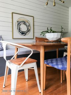 Eclectic table with built-in bench seat, mid-century decor, metal chair and danish table.