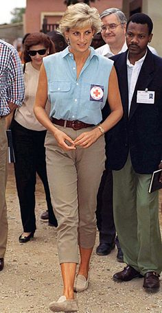 1997 | She visited patients at an Angola hospital wearing a sleeveless chambray shirt and trim chinos. | InStyle 22