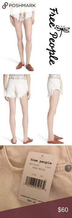 """New Free People Cutoff Denim Shorts Worn White Jean shorts, this white-washed version with a tied waist has dramatically ragged hems that look festival-ready. 2 1/2"""" inseam; 22"""" leg opening; 9 1/4"""" front rise; 13"""" back rise (size 26) Zip fly with button closure; removable tie at waist Five-pocket style. Signature boho silhouettes and eclectic details, Free People embodies the spirit of romance with a rock 'n' roll edge. Worn by wild-at-heart dreamers with ultra-feminine style. Color - worn…"""