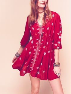 Adoring this embroidered tunic dress by Free People for a boho-inspired look.
