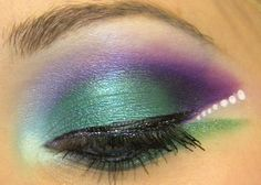 Sometimes, we gather creative inspiration from unexpected aspects of our lives. This was the case for YouTube beauty guru xsparkage, as she got the idea to do a 'Peacock Garden' makeup look after purchasing peacock themed decals for her laptop, iPhone, and Kindle. Teals, greens, blues, purples, and white all make up (haha) this bright and beautiful look. Watch the tutorial below.