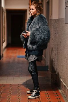 Fur with leather pants and Converse.