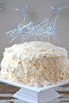 Coconut Dream Cake // Great dessert for New Years with fun DIY sparkler cake toppers!