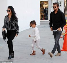 Stylish family: The trio looked like they were doing some serious shopping as they headed into RH Modern Furniture