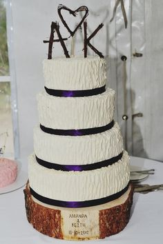 The bride's mom made the cake ~ & the branch cake topper and tree stump cake stand are PERFECT! click for more DIY details from Keith & Amanda's DIY wedding.