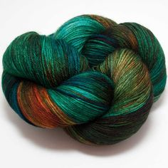 This fantastic hand-dyed yarn comes all the way from Ireland! With a super-soft feel and lovely drape its wonderful in luxurious socks, shawls and garments. 90% Superwash Merino Wool, 10% Nylon 100G =