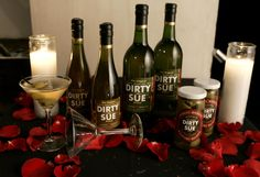 If you like dirty martinis, you will LOVE a dirty made with Dirty Sue!  Seriously, this is the BEST olive brine juice you can buy.  I got mine via Amazon.com!