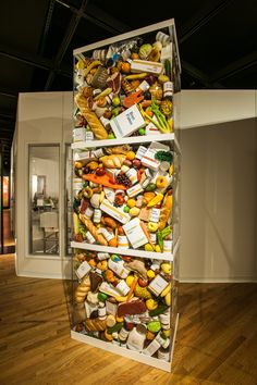 Each year, about 414 pounds of food is discarded for each person in the United States at home, in stores, and in restaurants. This installation in Our Global Kitchen represents the 1,656 pounds of food that is thrown away by a family of four. And this is just consumer waste—even more food is lost on farms and in processing and transportation. © AMNH/D. Finnin