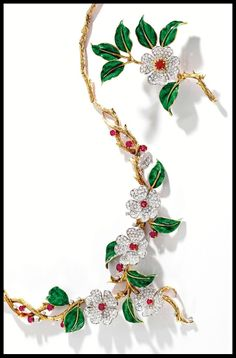Gold, diamond, enamel, and ruby dogwood flower suite by Boucheron, Paris. Via Diamonds in the Library.