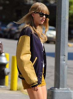 Taylor Swift this is one of my fave looks of her! she walks aroud like that with her guitar case looks so cool!!!