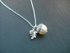 gorgeous necklace made with 12mm creamy white swarovski pearl adorned with heavy sterling silver plated acorn bead cap and antique silver pewter oak