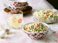 Individual Bowl of Pasta Salad on Table with Serving Bowl