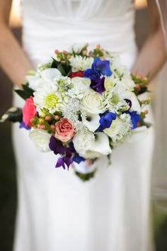 gorgeous bridal bouquet with shades of bright blue, pink and white by B and B Designs, photo by Mauricio Arias of Chrisman Studios | junebugweddings.com