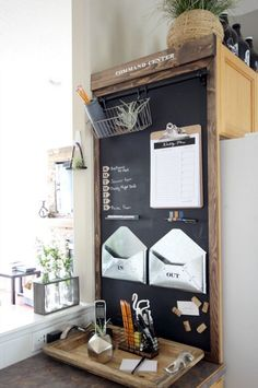Build Your Own Magnetic Chalkboard Industrial Command Center - the perfect organization idea! Great use of that blank wall beside the fridge!Industrial Command Center - the perfect organization idea! Great use of that blank wall beside the fridge! Command Center Kitchen, Family Command Center, Command Centers, Kitchen Chalkboard, Magnetic Chalkboard, Chalkboard Command Center, Framed Chalkboard, Chalkboard Ideas, Magnetic Whiteboard