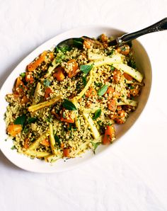 """""""Parsnips contribute an inherently cinnamon-spiced taste and meaty texture, balancing cubes of creamy pumpkin and refreshing mint,"""" Day writes of her Millet Couscous with Roasted Parsnips. Vegetable Dishes, Vegetable Pizza, Roasted Parsnips, Thanksgiving Table, Couscous, Paella, Cubes, Risotto, Meal Planning"""