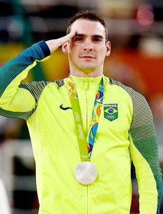 Silver medalist, Arthur Zanetti, of Brazil salutes during the national anthem of Greece, on the podium at the medal ceremony for Men's Rings on day 10 of the Rio 2016 Olympic Games.
