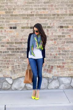 White blouse with navy blue sweater and blue dark casual plan jeans and brown leather hand bag and cute scarf and yellow high heels pumps