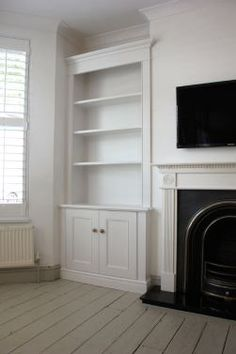 Bespoke Alcove Unit in Chiswick Alcove Storage Living Room, Living Room Cupboards, Built In Shelves Living Room, Living Room Bookcase, New Living Room, Bedroom Alcove, Bookshelves Around Fireplace, Alcove Bookshelves, Alcove Shelving