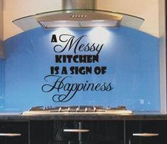 A messy Kitchen is a sign of happiness funny kitchen wall art sticker quote is available in various sizes and colours making it ideal to apply to any