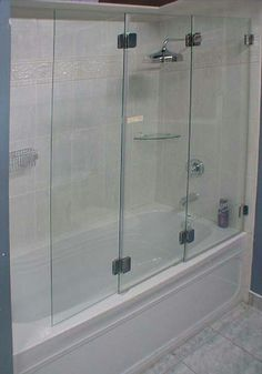European style shower door doorsandmore bathroom renos here we have one of our amazing tri fold doors ttd series on frameless glass shower planetlyrics Images