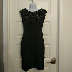 H&M black prismatic rhinestone dress nwt size s Brand new with tags. Sparkling rhinestone dress. Much nicer than in photo. U back. H&M Dresses Midi
