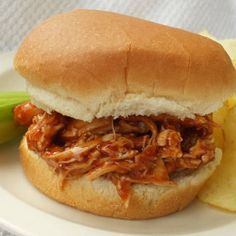 fast and easy pulled BBQ chicken recipe-just put the chicken breasts in a crock pot, cover with BBQ sauce, cook 3-4 hours on high, then shred using two forks | best stuff
