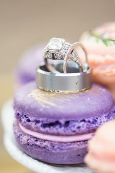 his and hers wedding rings on a wedding macaron
