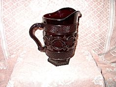 Avon Ruby Red Pitcher from the 1876 Cape Cod Collection by Avon Crystal,a very popular pressed glass pattern.This 42 Oz.Pitcher is 8 1/2 ins.tall.