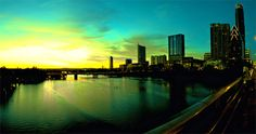This beautiful Shot of Panoramic Photography shows a lovely sunrise in the city. This image shows that it was taken on a bridge with the handrail across to the right. I love the colours in the light blue sky and water.