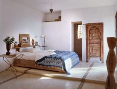 Serene, rustic bedroom. For a similar, low wooden bed try: http://www.naturalbedcompany.co.uk/product-category/low-beds/
