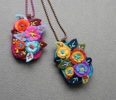 Embroidered felt necklace (pattern from the book Microcrafts). Such pretty -- and tiny -- flowers!