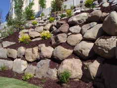 landscaping etaining walls | Retaining wall companies, Boulder walls, Dry stack flag stone walls ...