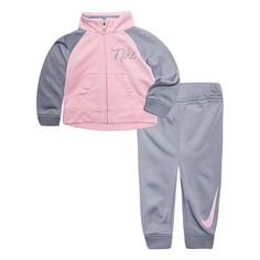 19d4cfac4c6b Relaxed style is effortless with this girls  Nike track jacket and pants  set. In pink gray.