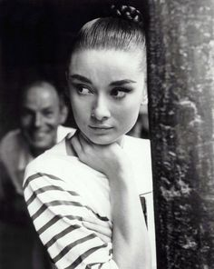 Such a rare shot of Audrey Hepburn!! It's beautiful! Looks like she's studying a scene or watching from backstage. So beautiful.