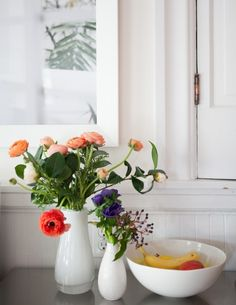 An Oakland Home Filled With Travel Mementos red and peach ranunculus bouquet