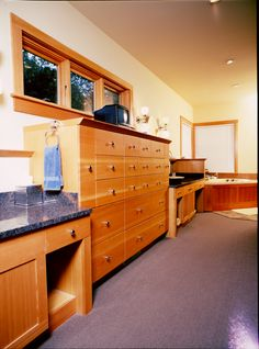 Fir wood species. Contemporary style bathroom dresser. Granite & Stainless Steel counter tops.