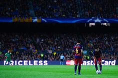 Neymar (R) and Dani Alves of FC Barcelona prepare to take a free kick during the UEFA Champions League Group E match between FC Barcelona and FC BATE Borisov at the Camp Nou on November 4, 2015 in Barcelona, Catalonia.