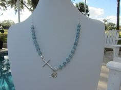 Faceted Aquamarine With A Sterling Silver Cross by JKCustomDesigns