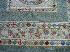 really like the flowered fabric in the middle border.