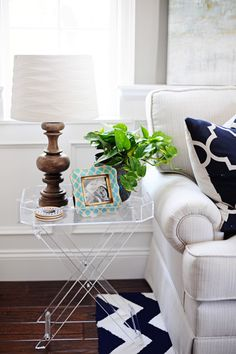 Lucite tables, like this one from HomeGoods, are a great way to dress up a small corner in your home.  Clear furniture takes up less visual space, so it doesn't overwhelm small areas. Sponsored pin.
